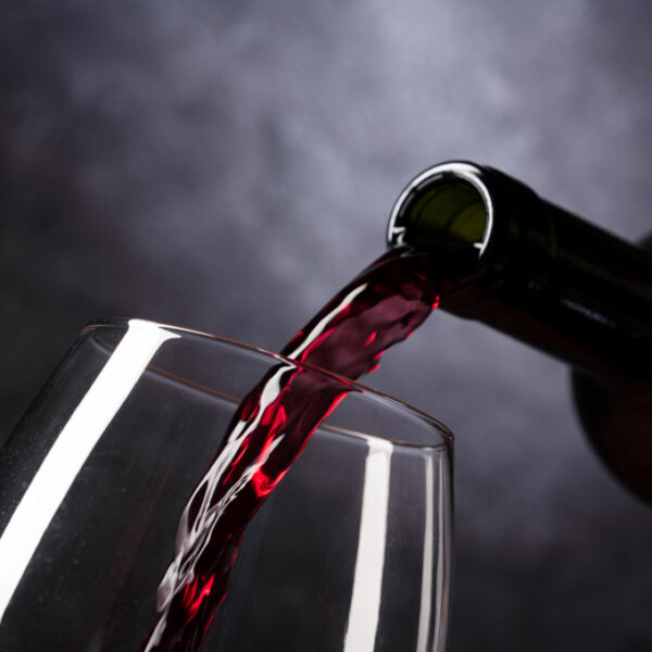 Bottle Pouring Red Wine Into Glass
